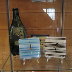 Glass clocks - 1 wine bottle shaped and 3 square shaped clocks.